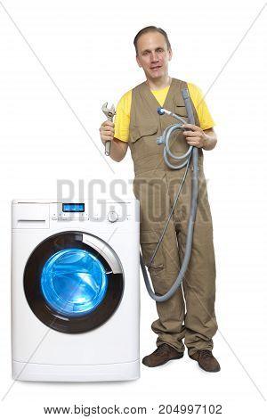 The repairman near the washing machine ,
