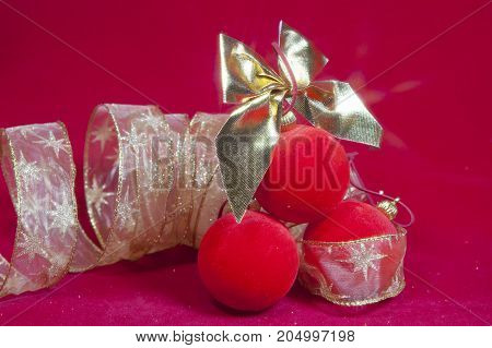 Red New Year balls and ribbon .