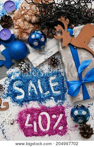Sales on Christmas and New Year holidays, top view reversed. Festive decoration with informative inscription of 40 pct discount for shop-windows, shopping malls and advertizing background concept