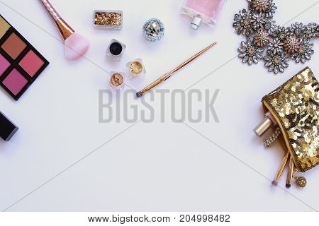 Styled elegant fashion and beauty supplies frame white copy space.