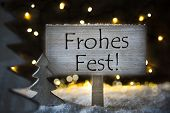 Sign With German Text Frohes Fest Means Merry Christmas. White Christmas Tree With Snow And Magic Glowing Lights In Backround. Card For Seasons Greetings. poster