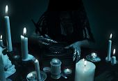 A sorceress holding a quill and magic book with pentagram symbol. Witchcraft composition, halloween concept, black magic ritual. poster