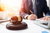Wooden gavel on table. Attorney working in courtroom. law attorney court judge justice gavel legal legislation concept poster