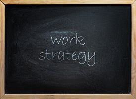 Work Strategy text written on black school board with wooden frame.