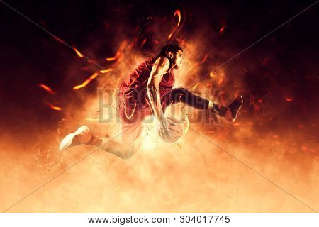 Basketball man player. Basketball concept on flames background – Image