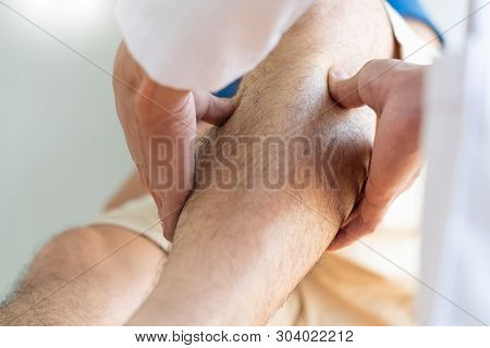 Physiotherapist Doctor Rehabilitation Consulting Physiotherapy Giving Exercising Leg Treatment With