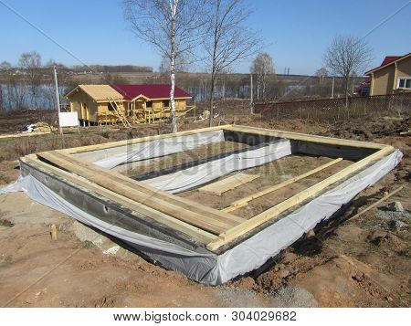 Wooden formwork, concrete strip foundation for a house. close-up of a wooden formwork with steel reinforcements for the preparation of the slab. concrete casting , home building structure. poster