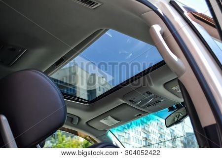 View Of The Ceiling Of The Car With A Transparent Glass Hatch For Airing, Opening So That You Can Se