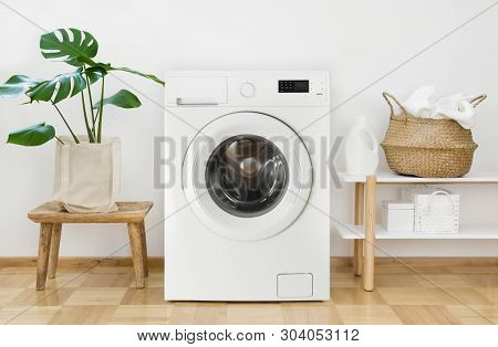 Clothes Washing Machine In Laundry Room Interior