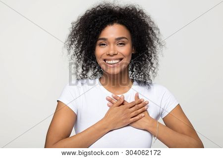 Headshot Portrait American Woman Holding Hand On Heart Feels Gratitude