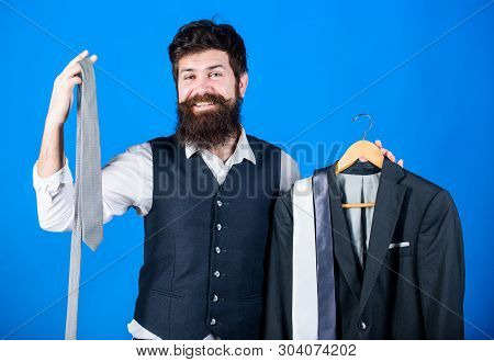 Perfect Necktie. Shopping Concept. Stylist Advice. Difficulty Choosing Necktie. Shop Assistant Or Pe