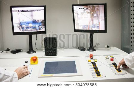 Chernobyl, Ukraine -  October 16, 2015: Engineers Monitoring Nuclear Reprocessing In A Control Room