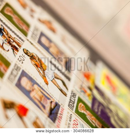 Kyiv, Ukraine -  March 24, 2019: Collection Of Mexican And Other Stamps In The Album. Collection Of