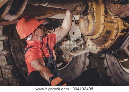 Heavy Duty Mining Dump Truck Differential Problem. Caucasian Driver Trying To Bush Fix. Heavy Duty E