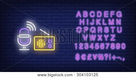Microphone And Radio Receiver Neon Sign. Glowing Neon Microphone And Radio Receiver On Dark Blue Bri