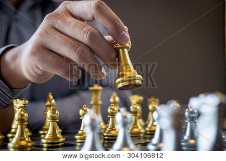 Gold And Silver Chess With Player, Intelligent Businessman Playing Chess Game Competition To Plannin