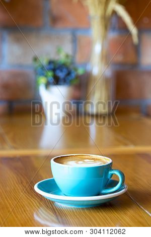 A Cups Of Cappuccino With Latte Art On Wooden Background. Beautiful Foam, Greenery Ceramic Cups, Sty