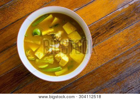 Yellow Curry With Fish And Bamboo Shoot Thai Southern Style Food On Wooden Table