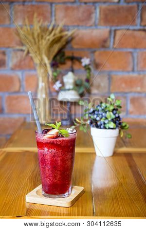 Healthy Strawberry Smoothie In A Mason A Jar Mug Over A Rustic Wood And Brick Wall Background