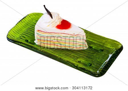 Slice Cream Cake Topped With Fresh Fruit Such As Grapes,   In A Green Plate On A White Background