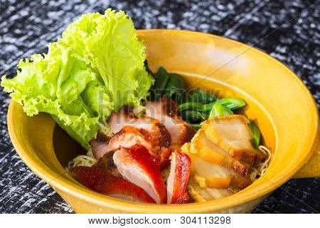 Egg Noodle With Red Roast Pork, Crispy Pork, Dumplings, Soup And Condiments