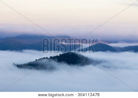 Distant Mountain Range And Thin Layer Of Clouds On The Valleys,mae Hong Son Thailand.