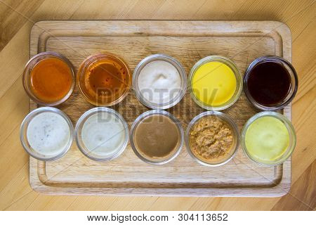 Bowls With Sauces On Wooden Tray ,sandwich Dressing.