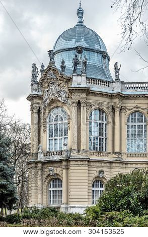 Landmark With Grey Baroque Dome And Small Sculptures Of People, Budapest, Vajdahunyad Castle
