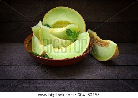 Juicy (succulent) And Delicious Melon, Slices Of Melon (cantaloupe) In Bowl