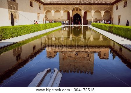 Granada, Spain. May 3, 2017 : Reflection In The Pond Water Of The Patio De Los Arrayanes Building (c