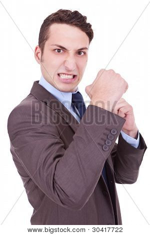 angry business man holding his fists into camera. Isolated on white background