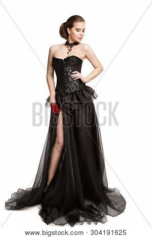 Fashion Model In Black Corset Dress Holding Red Rose Flower, Beautiful Woman In Long Gown, Isolated