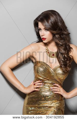 Fashion Model Gold Dress, Young Elegant Woman Beauty Studio Portrait, Long Hair