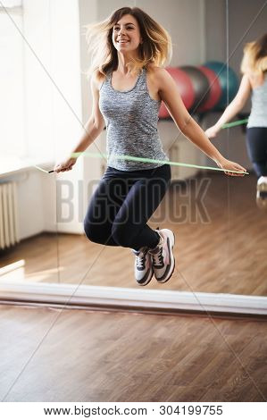 Cardio Workout, Endurance, Jump-fit, Vitality, Active Lifestyle. Sporty Woman Training With Jumping