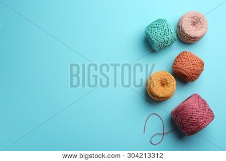 Clews Of Knitting Threads On Color Background, Flat Lay With Space For Text. Sewing Stuff