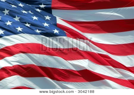 Photo of American flag waving in the wind. poster