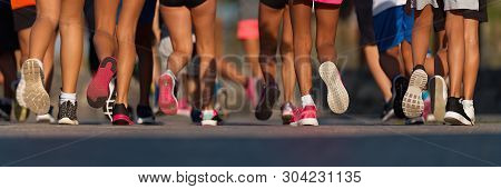 poster of Running children, young athletes run in a kids run race,running on city road detail on legs,running in the light of morning
