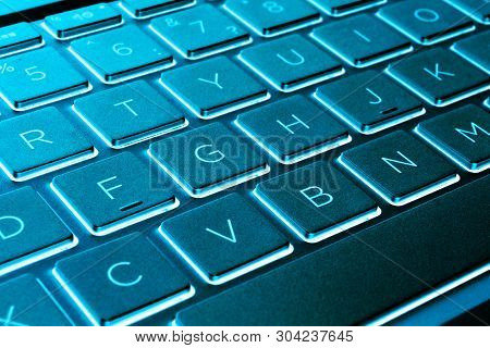 Closeup Of A Modern Silver Laptop Computer Keyboard. Laptop Keyboard. Detail Of The New And Ergonomi