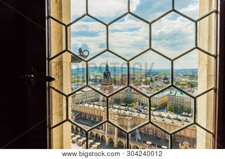 Krakow Poland. April 2019. An Elevated View Through St Marys Basillica Window Over The Medieval Old