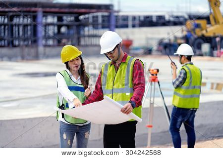 Surveyor Engineer With Theodolite At Construction Site During Surveying Work.engineer And Architect