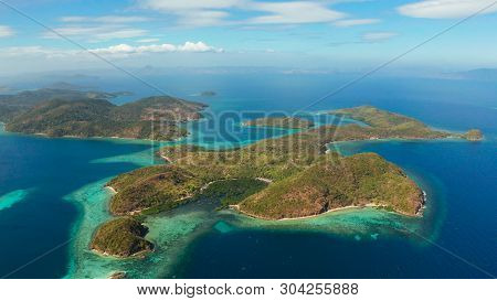 Aerial Seascape Lagoons With Blue, Azure Water In Middle Of Small Islands. Palawan, Philippines. Tro