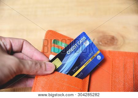 Credit Card In Wallet With Hand / Online Paying From Home Or Increased Liabilities Debt Credit Card