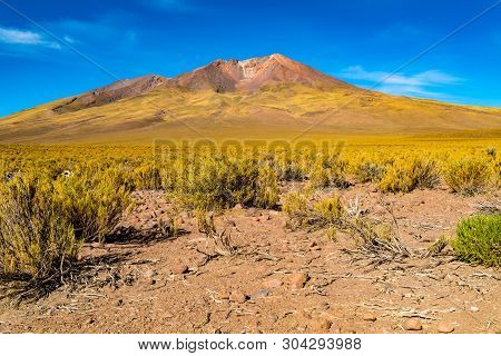 Volcanic Landscape At Uyunu In Bolivia With The Dormant Tunupa Volcano