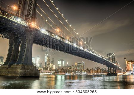 Manhattan Bridge Taken From Brooklyn Bridge Park At Night.