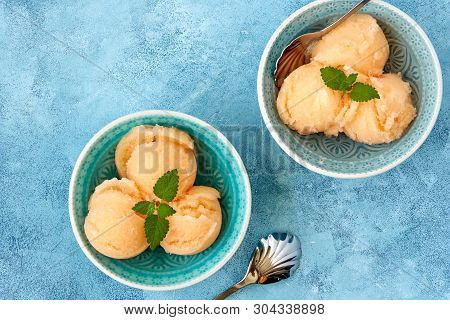 Homemade Melon, Apricot Or Peach Ice Cream , Sorbet In Bowl With Mint Leaves. Top View, Copy Space