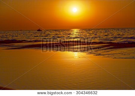 Warm, Amazing Sea Wave Close Up On The Beach Sunrise Like A Sunset, Nature Landscape Background.