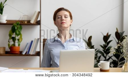 Businesswoman Stretching Shoulders After Hard Work Feeling Discomfort At Work