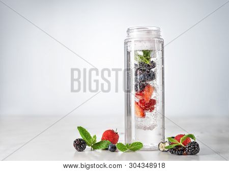 Infused Water In Plastic Bottle With Berries