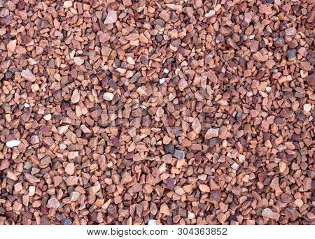 Red Marble Chips Texture For Use In Landscape Design, And Decoration In Floristics