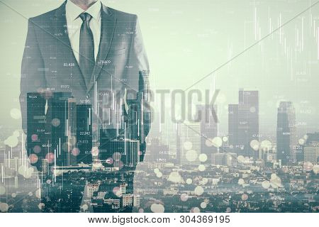 Businessman Standing On Abstract City Background With Forex Chart And Blurry Bokeh Circles. Stats An